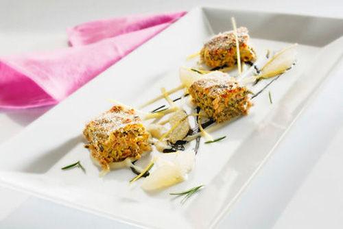 Polpettone genovese su crema di patate, pompelmo e nero di seppia
