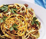 Spaghetti con uvetta e arance