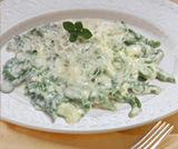 Spätzle di spinaci con fonduta al formaggio