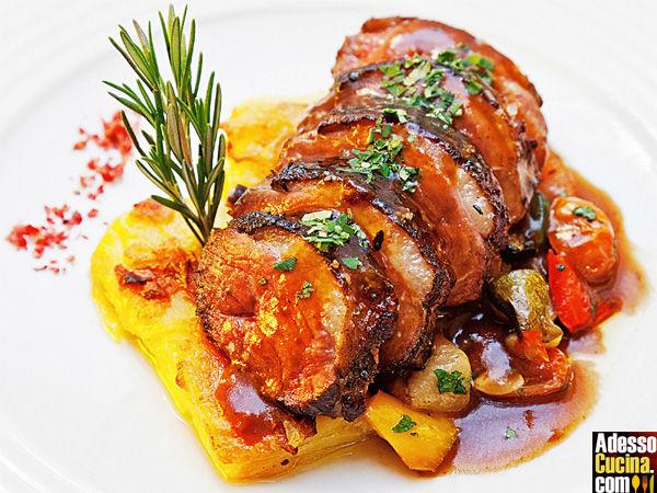 Filetto in salsa d'arancia con contorno di patate Duchessa