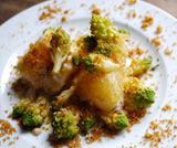 Trancio di stoccafisso croccante con broccolo romano e briciole di pane
