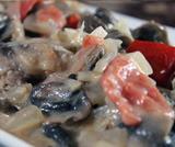 Cartoccio di alici, pomodori e prosciutto