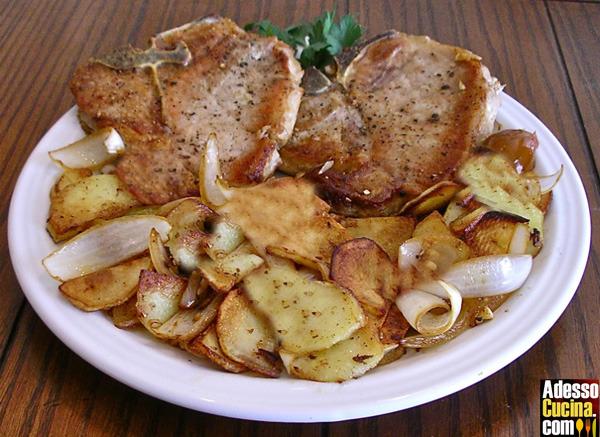 Braciole di maiale al forno con patate
